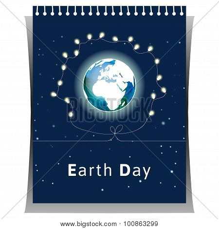 Tear-off calendar with globe and with light bulbs as concept for Earth Day.