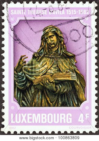 LUXEMBOURG - CIRCA 1982: A stamp printed in Luxembourg shows St. Theresa of Avila (1515- 1582)