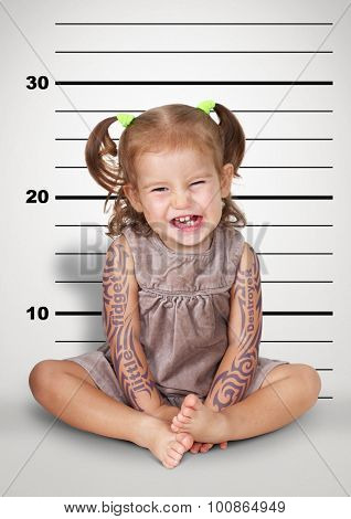 Mugshot Of Funny Naughty Baby With Tattoo, Disobedient Child Concept.