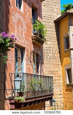 BARCELONA, SPAIN - MAY 02: Architectural Detail of Iron Railing Balcony on Exterior of Colorful Building with Ornate Facade in Historical Poble Espanyol Museum Area, Barcelona, Spain. May 02, 2015.