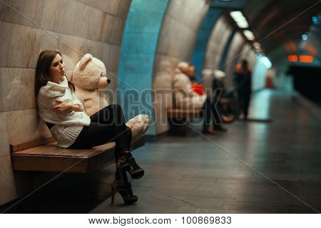 Girl Is Sad Sitting On The Bench.