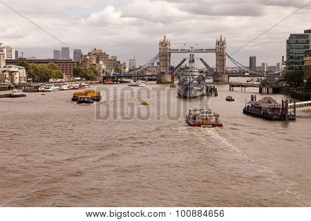 Hms Belfast And Tower Bridge Amidst River Thames
