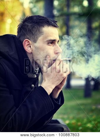 Sad Man With Cigarette