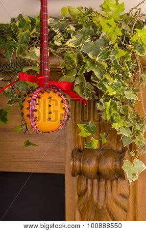 Christingle Orange Hanging on a Fire surround