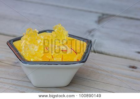 Nabat Persian saffron enhanced crystallized sugar on a wooden table poster