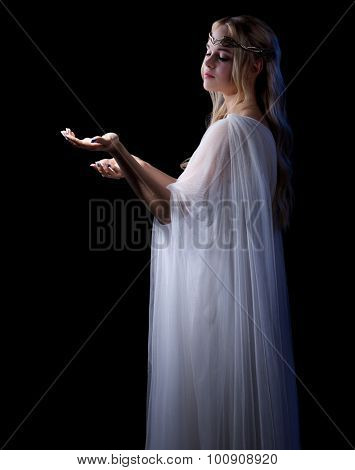 Young elven girl isolated on black poster