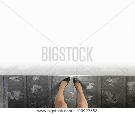 Woman standing on the edge of the roof