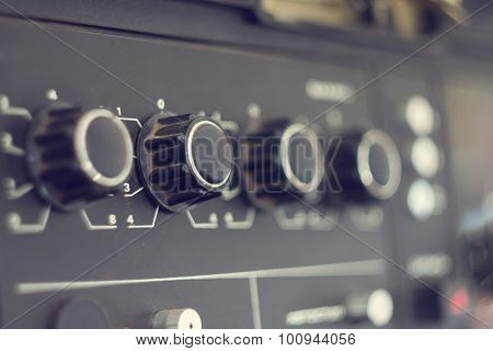 Piece Of Electrical Audio Equipment With Knobs