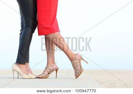 Couple Of Lesbian Women Legs Cuddling With Love