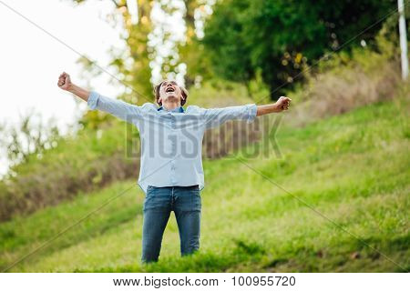 Successful Man With Open Arms Celebrating