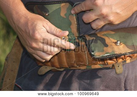 Laying of ammunition in a bandolier.