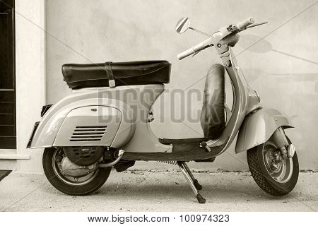 Classic Vespa Scooter Near The Wall