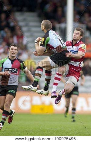 TWICKENHAM, ENGLAND. 17 SEPTEMBER 2011. Harlequins Mike Brown, is tackled in the air by Gloucester's Henry Trinder, during the premiership rugby union match between Harlequins and Gloucester