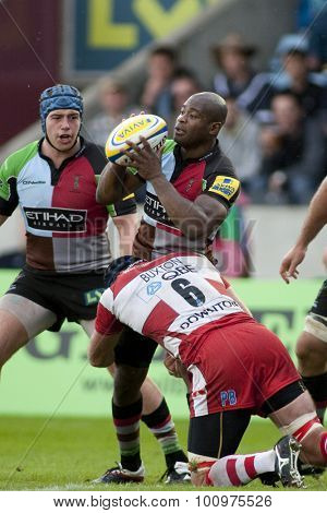 TWICKENHAM, ENGLAND. 17 SEPTEMBER 2011. Harlequins Ugo Monye, is tackled by Gloucester's Peter Buxton  during the Aviva premiership rugby union match between Harlequins and Gloucester