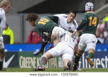 TWICKENHAM LONDON, 27 NOVEMBER 2010.  South Africa's Zane Kirchner, is tackled by England's Andrew Sheridan and Shontayne Hape, during the Investec International match between England and South Africa