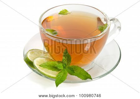 Glass Cup Tea With Mint And Slices Of Lime , Isolated On White Background.