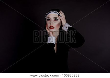 Halloween. Girl Dressed In Evil Sexy Nun