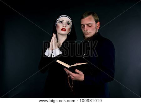 Halloween. A Man And Woman Dressed As The Clergy