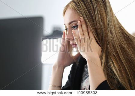 Young Beautiful Upset Business Woman Trying To Concentrate