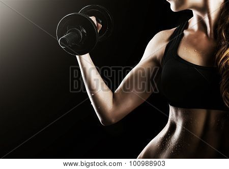 Female Muscular Arms With Dumbbells