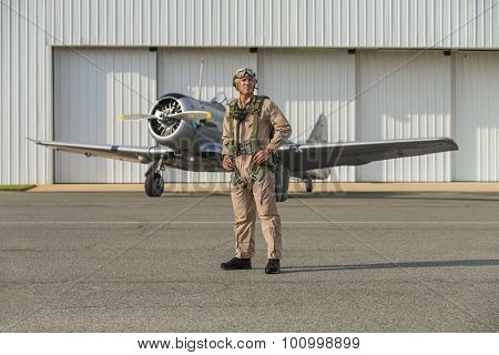 A WWII military pilot with his SNJ5 aircraft returning from a mission poster