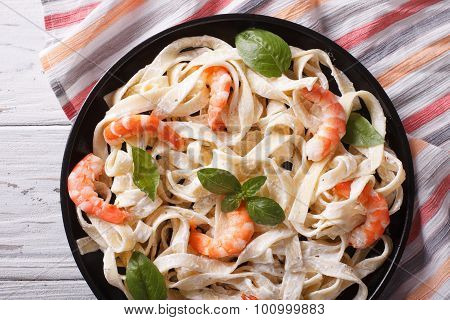 Fettuccini Pasta In Cream Sauce With Shrimp Close-up. Horizontal Top View
