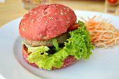 Tasty pink burger with meat, salad and strawberry poster