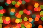 christmas lights; blurred coloured lights at night poster