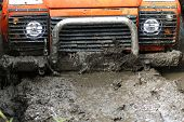 UKRAINE - JULY 28 - Land Rover Defender sinks in mud during a race on July 28 2015 in Ukraine. poster