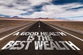 A Good Health is the Best Wealth written on desert road poster
