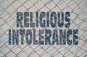 Text under a wire netting about religious intolerance and violence poster
