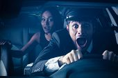 Male chauffeur with woman on back seat gets into car crash and makes ridiculous face poster