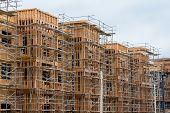 New wood frame apartment or condominium construction poster
