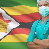Surgeon with flag on background - Zimbabwe poster