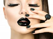 Beautiful Fashion Model woman with Long Lushes and Black make up isolated on white. Fashion Trendy Caviar Black Manicure. Nail Art. Dark Lipstick and Nail Polish. Vogue style poster