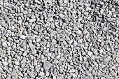 Texture of granite gravel. High resolution image of granite gravel in construction industry poster