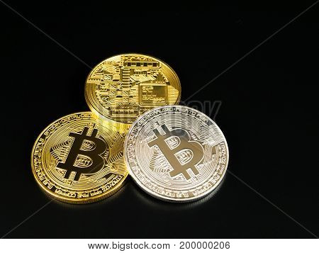 Golden and silver bitcoin on black background. Bitcoin cryptocurrency