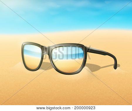 Glasses on blurred beach. Summertime background. Sand.