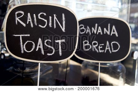 Raisin Toast and Banana bread sign in at cafe.