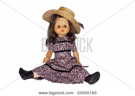 vintage doll sitting isolated on white