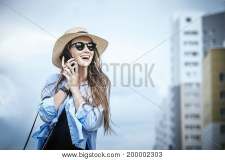 Young Beautiful Woman Model Lady Fancy Shirt And Hat With A Mobile Phone On A City Street