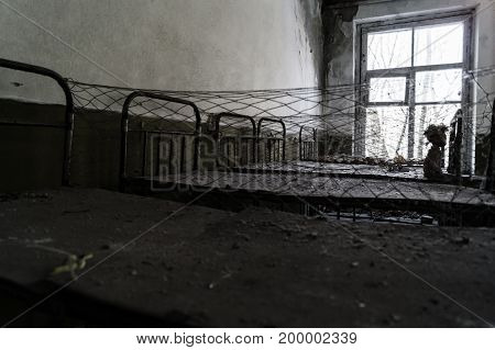 A desolate abandoned nursery after a terrible Chernobyl event