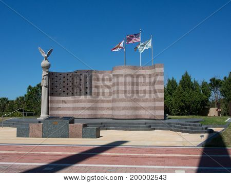 A flag made of granite standing at Freedom Park in Naples, Florida. The base is the  Continental US made of granite also.
