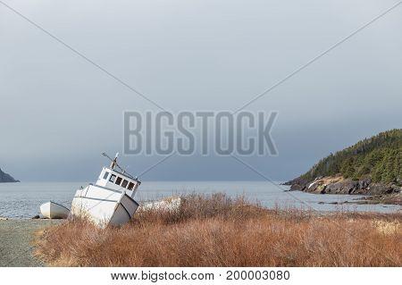 Stranded White Boat