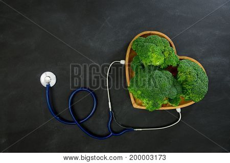 Green Broccoli Vegetable In Wooden Plate As Heart