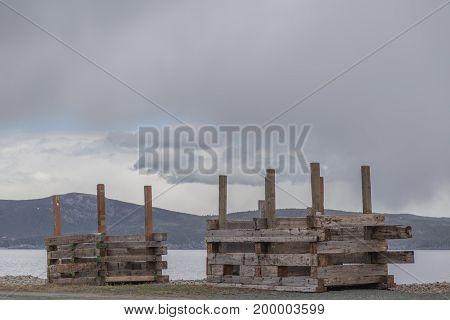 Wood Palettes On Shore