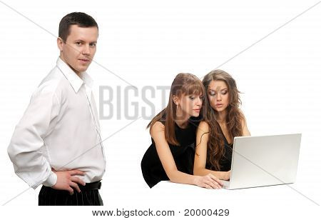 Man And Two Women With The Computer