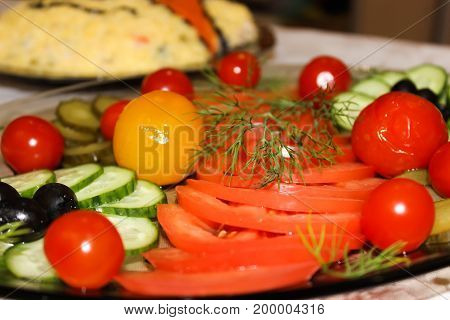 Different vegetables are laid out on a dish for a holiday