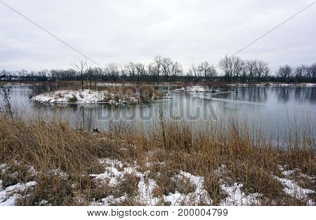 A view of the quarry pond in the Rock Run Preserve of Joliet, Illinois, during January.