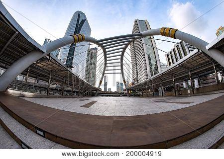 Cityscape of Bangkok with Chong Nonsi skywalk bridge Bangkok Thailand